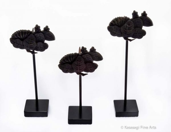 Three Kugikakushi Decorative Nail Covers on Custom Stands