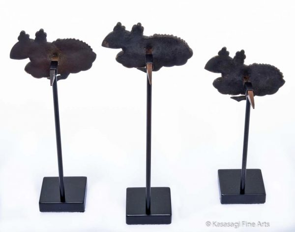 Three Kugikakushi Decorative Nail Covers on Custom Stands