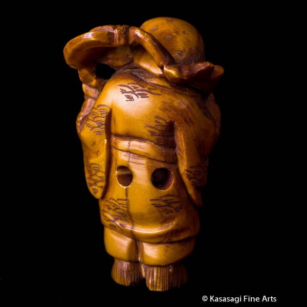 Okina Netsuke With Lotus Leaf